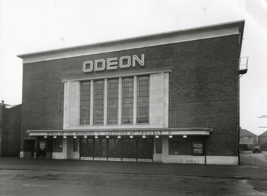 Odeon Cinema. Large rectagular building with ODEON written along the building. | Watford Museum