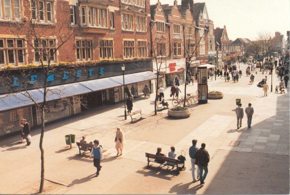 View of Clements department store taken from the flyover. Pedestrians walking along high street. | Watford Museum, Halcyon of Bushey Postcard