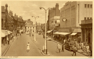 View of the High Street. Mid 20th century. Busy with pedestrians. View of Cawdells | Watford Museum