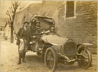 Claude driving a vehicle in World War One