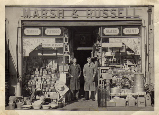A photo of Marsh & Russell taken in the early fifties, with manager Mr Harold D'eath and assistant manager Mr Eric Knight. | Photo supplied by James Russell.