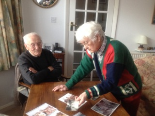 Mrs Sylvia Coles looking through her photographs with her husband.    Maggie Cheal, Watford Live!