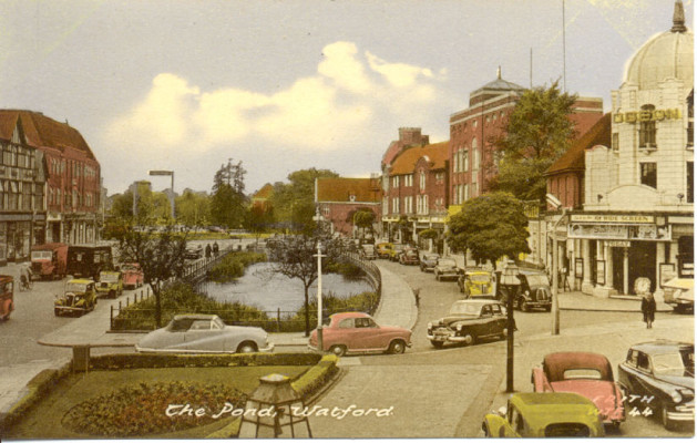 View of the pond on the parade and the Odeon cinema in the 1950s. | Frith Series Postcard.