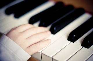 Close-up of fingers playing piano. | Photo by Manuela Hoffman