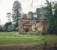 Across front lawn to the dining room and main house