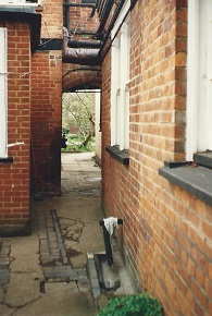 Kitchen passage towards back garden.  Door to dining room tucked round to the right